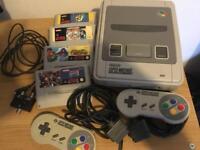 Super Nintendo (SNES) console + 4 games