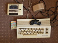 Commodore 64 PC working + 1x faulty C64 boxed lots of games but no power supplys