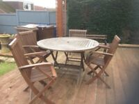 Four wooden matching chairs and table set.
