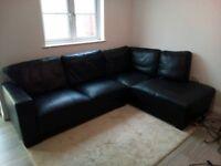 Black leather corner sofa right hand