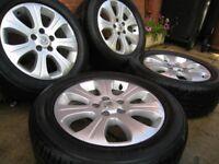 vauxhall 16 inch alloy wheels / 5 stud , good tyres