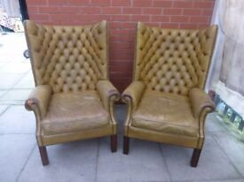 A Pair Of Antique Olive/Yellow Chesterfield Arm Chairs