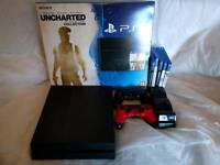 PS4 500GB with 5 games 2 genuine controllers & charging dock