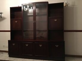 Display cabinet for living room. 2 pieces, mahogany with glass panels and electric lights