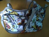Butterfly slouch bag
