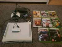 Xbox 360 console. Including 8 games, 1 Wireless controller and wireless broadband receiver.