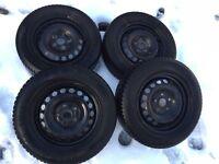 Set of 4 steel wheel rims and Vredstein Snowtrac 5 winter tyres.