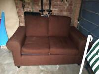 Brown two seater setee
