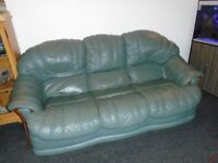 Green Leather sofa and reclining arm chair.