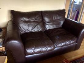 Luxurious 2 seater leather sofa with detachable cushions. £200 ONO