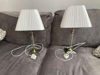 Table lamps with detailed bases. One has a small mark on the back as shown. £10 the pair. Torquay.