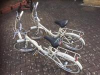 pair Raleigh Compact folding bicycles bikes