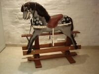 A BEAUTIFUL HARDWOOD ROCKING HORSE