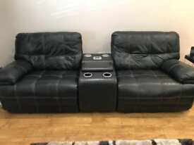 Leather reclining sofas and chair with in-built Bluetooth speakers and drinks coolers.
