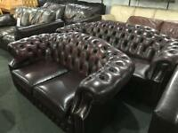 As new dark oxblood 3 and 2 sofas