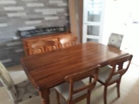 Dinning room table/chairs/sideboard/small table and cabinet