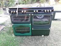 Range cooker with extractor hood and instructions