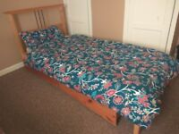 Pine single bed with mattress and storage
