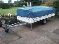 Trailer tent with camp kitchen attached, includes cooker and sink. Huge awning. 4 to 6 berth.