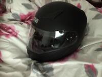 Flip up helmet with sun visor fitted