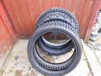 shed clearout! misc dirt bike tyres and unknown wheel.
