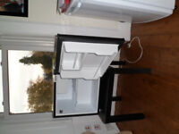 Black, Russell Hobbs Table Top fridge with accompanying table for sale. £60.00 ono.
