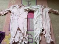 Girls 6-9 months babygrows and pyjamas