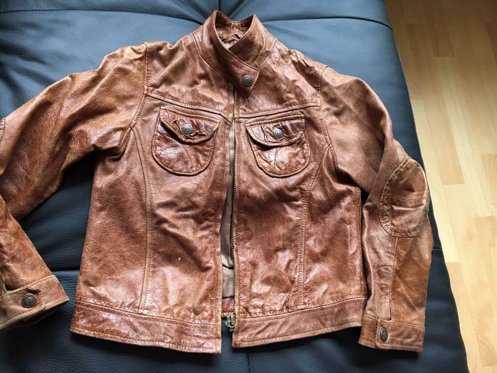 Next brown real leather jacket 7/8y4in St Helens, MerseysideGumtree - Next Brown Real leather jacket there is a little white dot on the front as seen in the picture but other than that in very good condition. smoke free home can post out for extra charge or collection Sutton Heath Read less