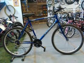 ADULTS/OLDER CHILDS UNIVERSAL RAMPAGE BIKE 26 INCH WHEELS 15 SPEED BLUE OK CONDITION
