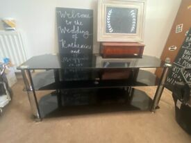 Black glass tv stand - great condition!