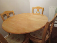 Pine circular table and four chairs