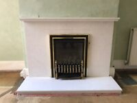 Marble fireplace surround and pebble gas fire