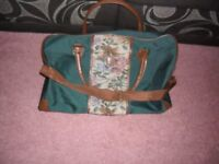 Green holdall with handles and shoulder strap