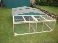 very big rabbit/guinea pig hutch and run half covered half open
