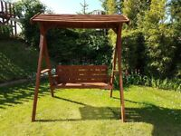 Wooden garden swing with canopy