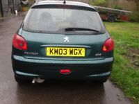 peugeot 206 Roland Garros model, dark green with tan leather interior and green inserts