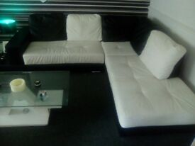 Leather black and white corner couch