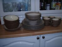 Collection of Denby crocery...including four dinner plates, bowls. dishes and mugs