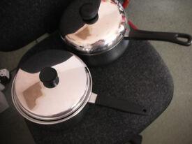 2 x larger pans with lids
