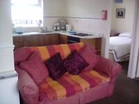 Holiday bungalow sleeps 6 in Gower Holiday Village. Two bedrooms. Swimming pool , play area.