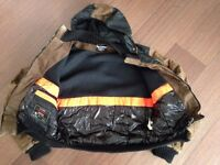 Jacket RefrigiWear brown used Medium size keep very warm well made few little holes on the side.