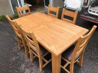 New/ex-display**Large solid oak extendable table and 6 chairs - delivery available