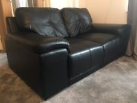 Designer black leather sofas settees - 3 seater and 2 seater. Great condition.