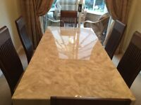 Barker and Stonehouse marble table and six solid wood mahogany chairs