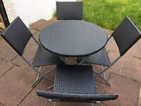 Garden table and 4 chairs in a very good condition