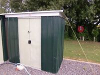 metal shed - 6 foot wide x 67 inch high x 39 inch deep approximately