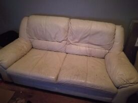 Cream leather sofa, & it'd benefit from a good clean. Perfect for a first time home.