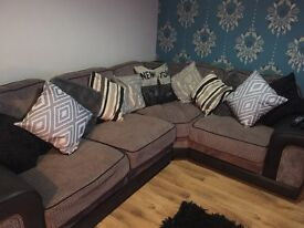 Grey and black corner sofa very comfortable comes with cushions
