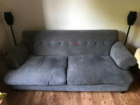 DFS Grey sofa with multi coloured button. Seats 4