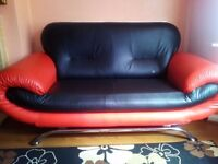 genuine back & red leathered sofa in mint condition